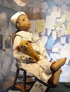 Robert the doll sitting in the East Martello Museum