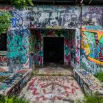 The entrance to the Krome Insane Asylum, showing the graffiti and abandoned interior.